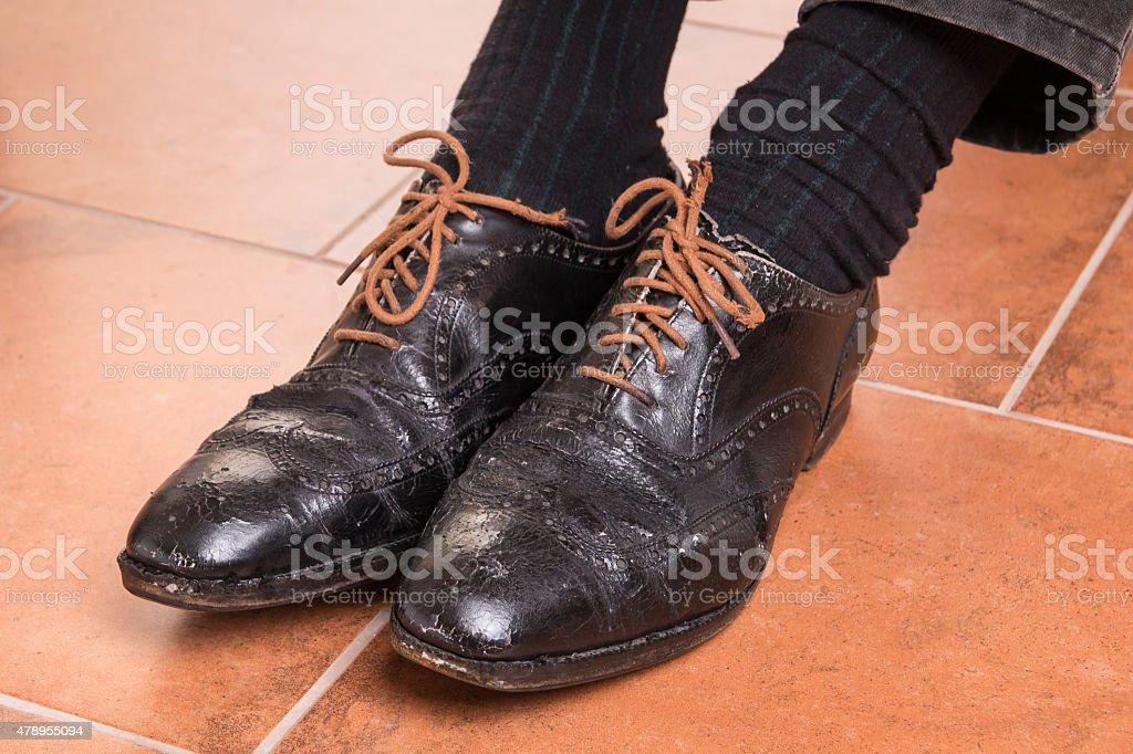 Damaged leather shoes stock photo