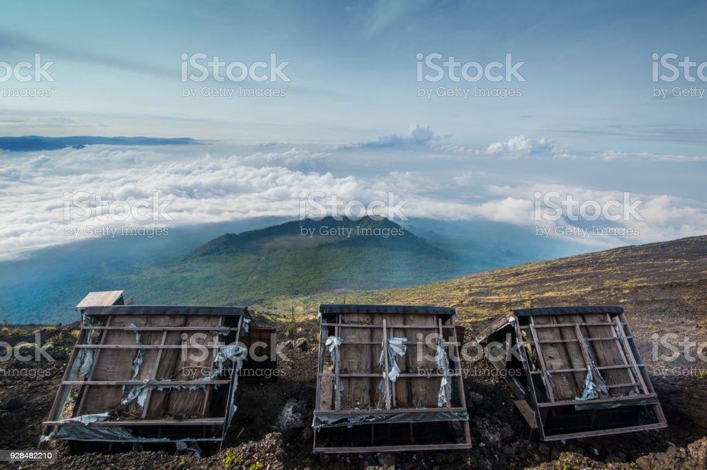 Damaged mountain huts on summit of Nyiragongo volcano stock photo