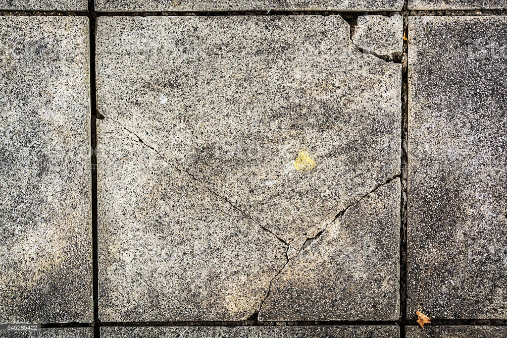 Damaged paving blocks texture - abstract texture background stock photo