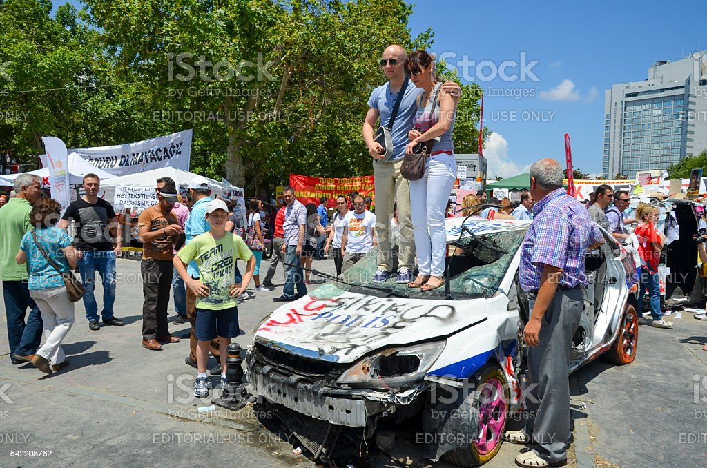 Damaged police car and memories people photographer. It has started...