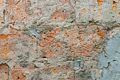 istock damaged red bricks wall with concrete texture 1298604515