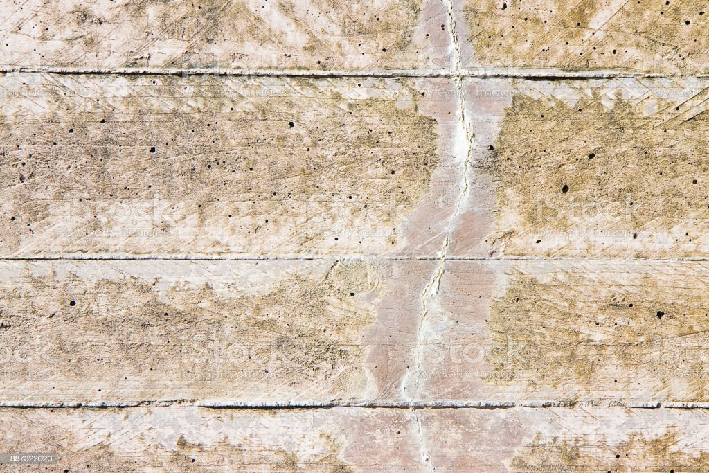 Damaged reinforced concrete wall with cracks stock photo