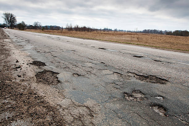 damaged road - deterioration stock pictures, royalty-free photos & images