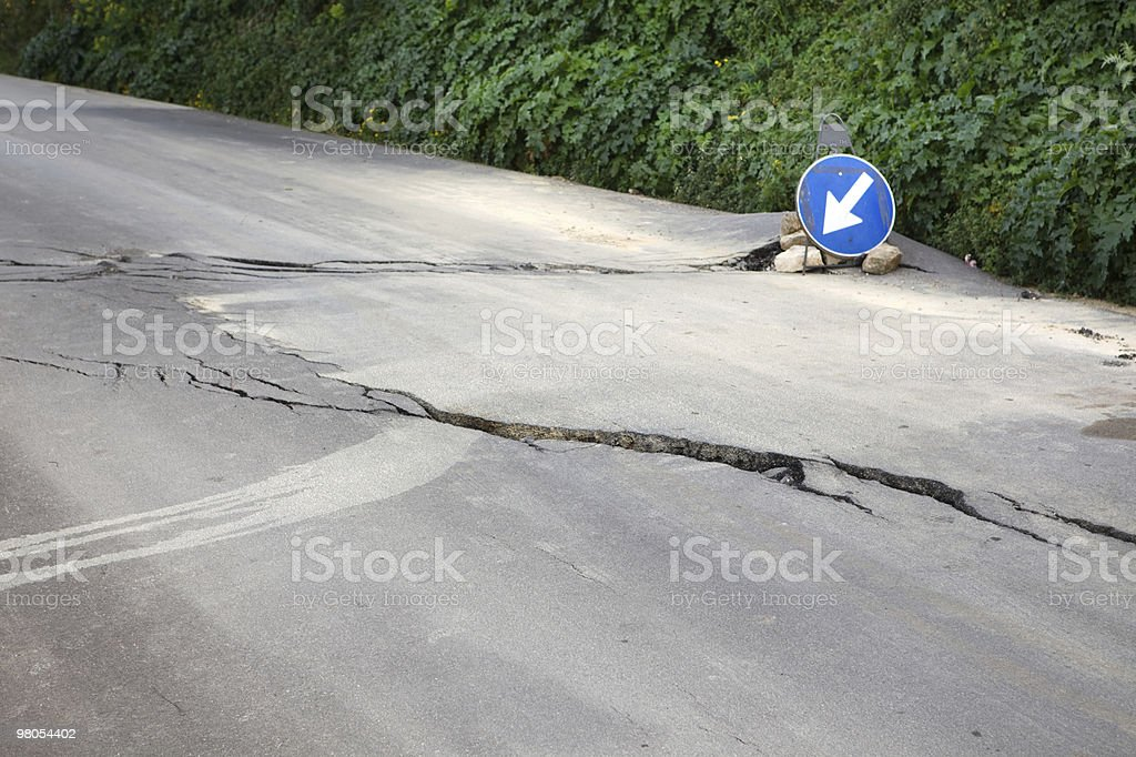 Damaged road with big cracks royalty-free stock photo