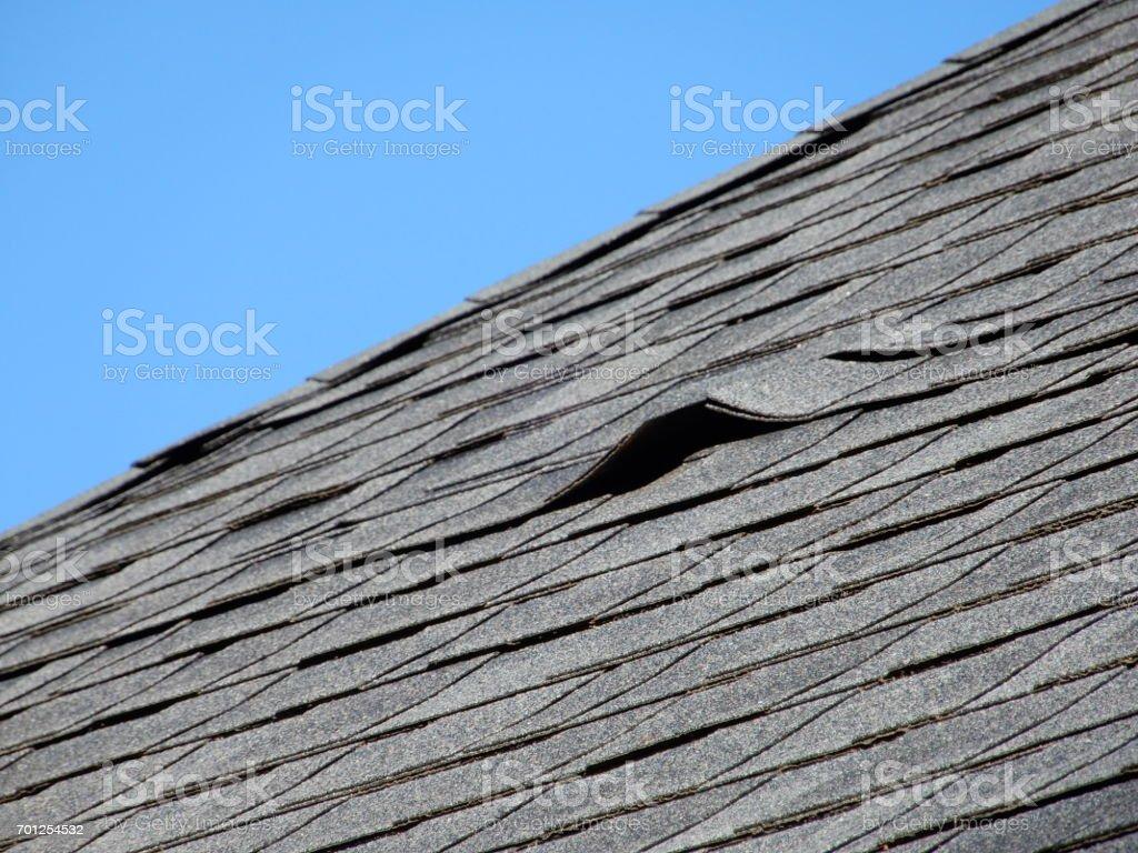 Damaged Roof Shingle stock photo