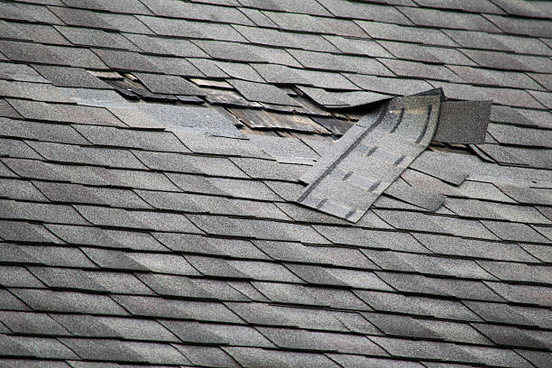 damaged roof shingles - curled up stock pictures, royalty-free photos & images