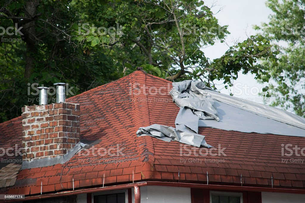 Damaged Roof Shingles stock photo