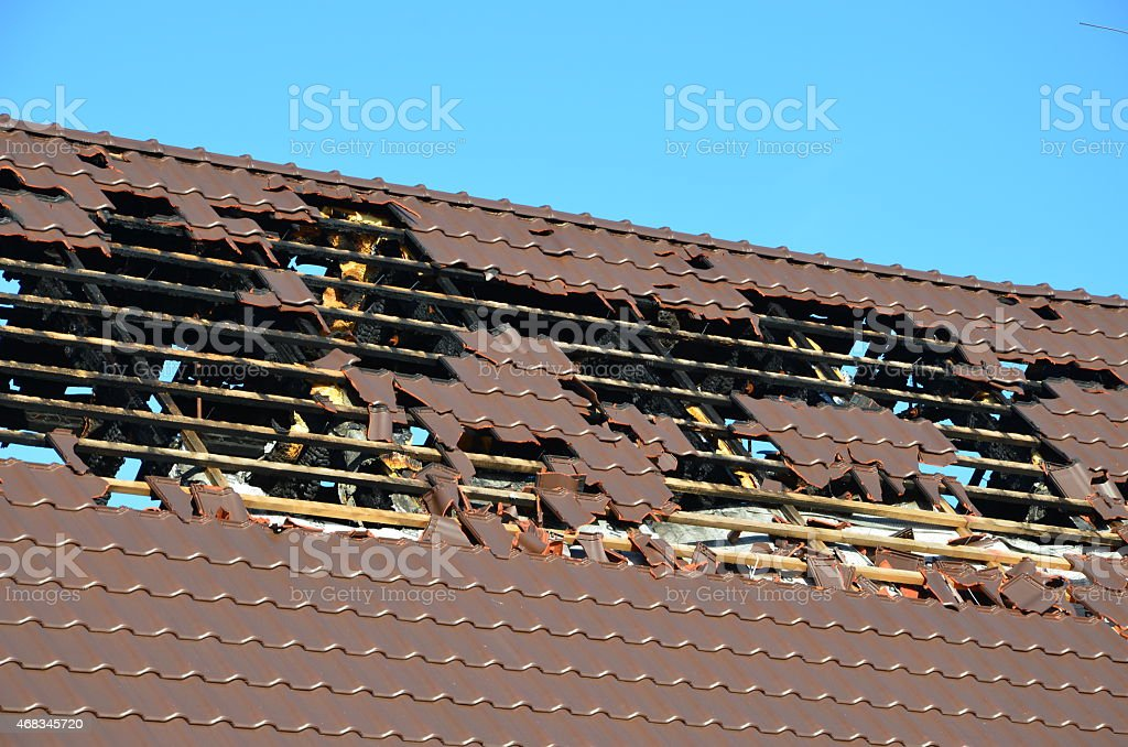 damaged roof truss stock photo