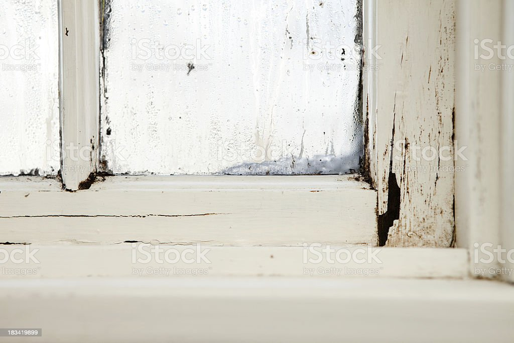 Damaged, Rotting Window Inside Older Home stock photo