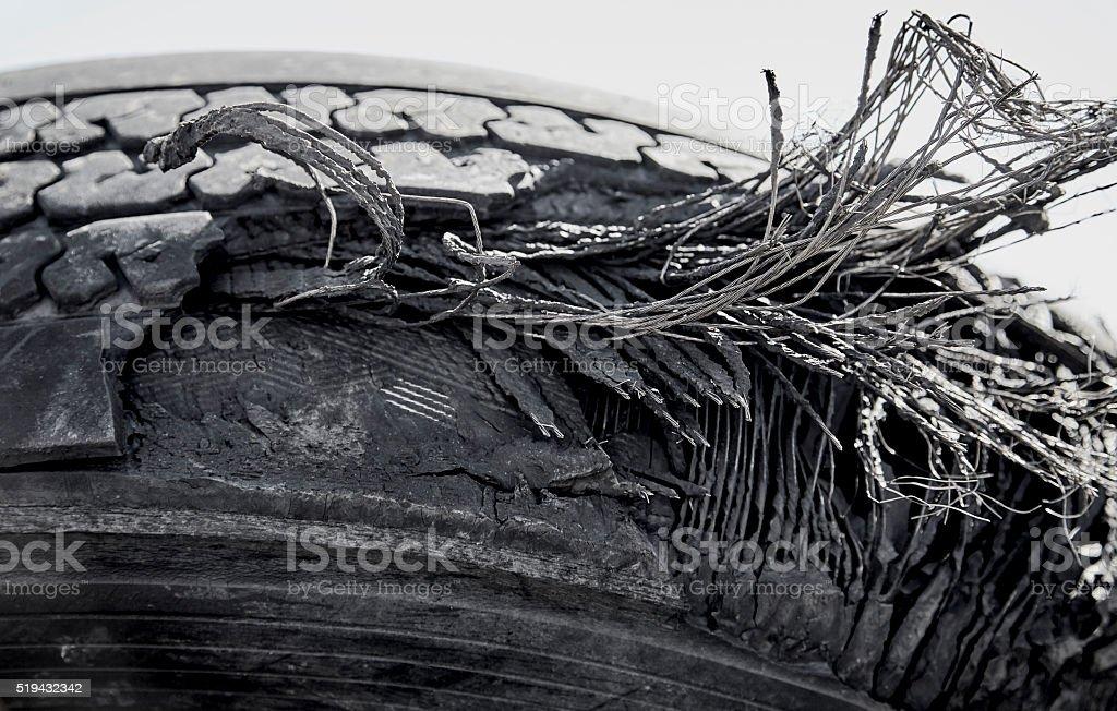 Damaged Ruptured Truck Tire Closeup stock photo