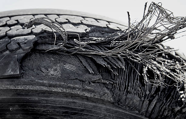 damaged ruptured truck tire closeup - incomplete stock pictures, royalty-free photos & images