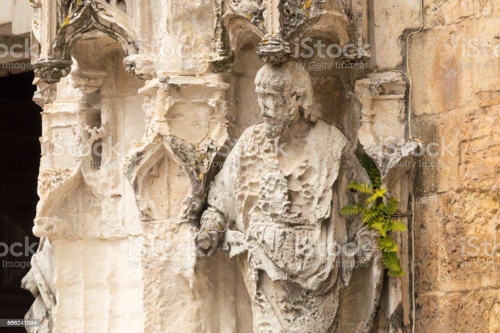 Damaged statue at the entrance of the Igreja de Santa Cruz, Coimbra, Portugal stock photo
