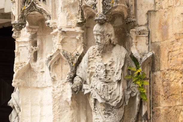 Damaged statue at the entrance of the Igreja de Santa Cruz, Coimbra, Portugal stock photo