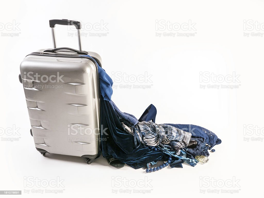 Damaged Suitcase Spinner loses its blue female contents stock photo