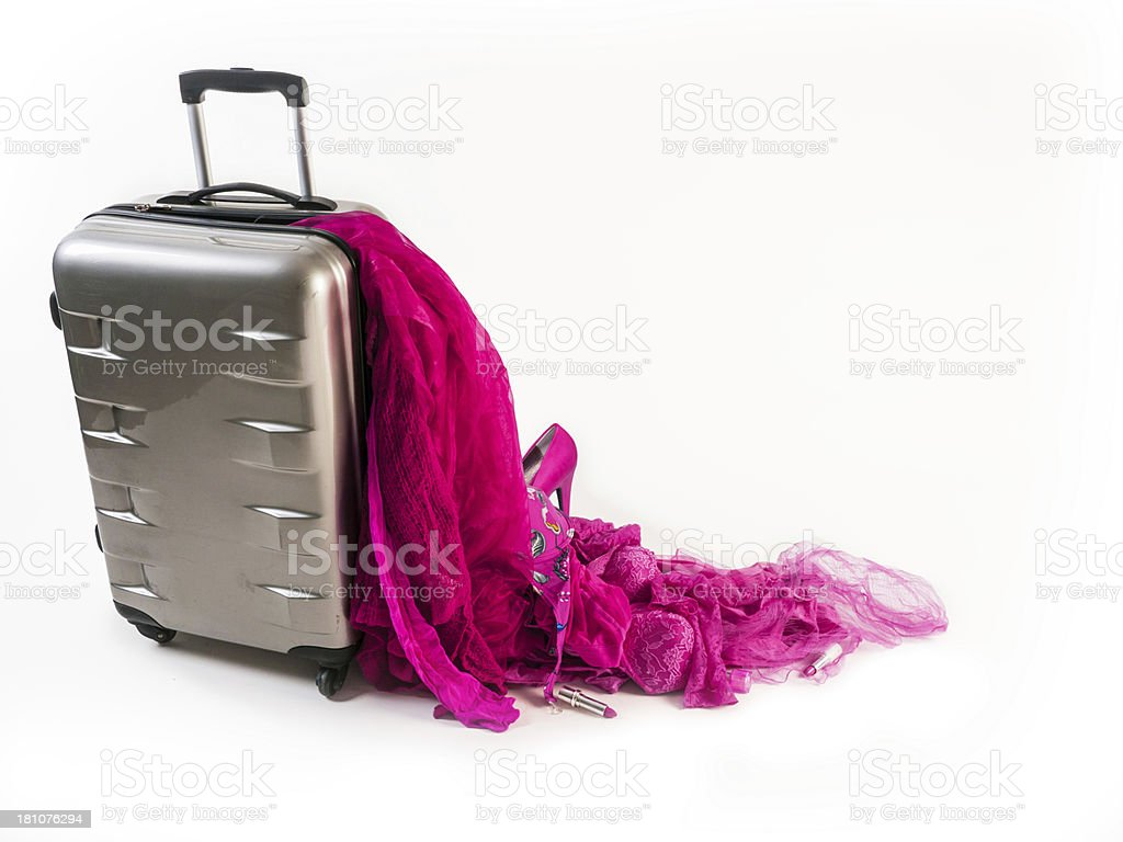 Damaged Suitcase Spinner loses its pink female contence stock photo