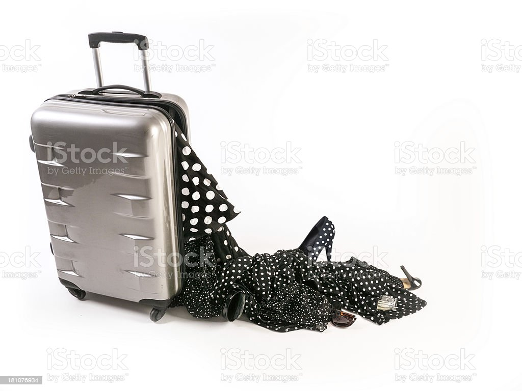 Damaged Suitcase Spinner loses its polka dots female contence stock photo