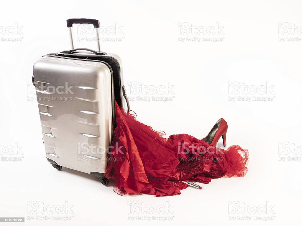 Damaged Suitcase Spinner loses its red female contents stock photo