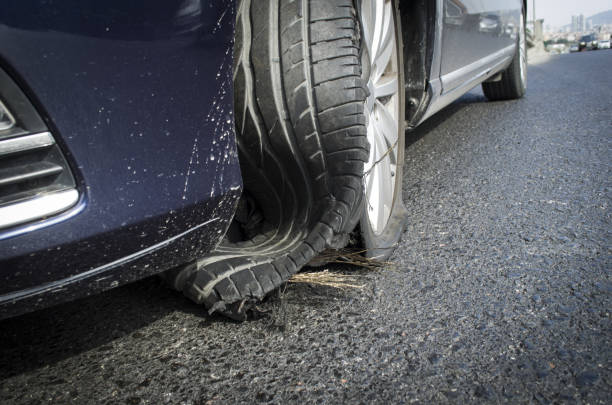 damaged tire after tire explosion at high speed on highway - impaired driving stock photos and pictures