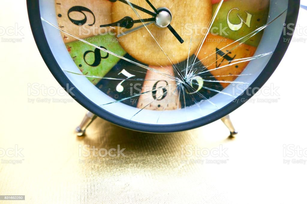 Damaged vintage colorful alarm clock stock photo