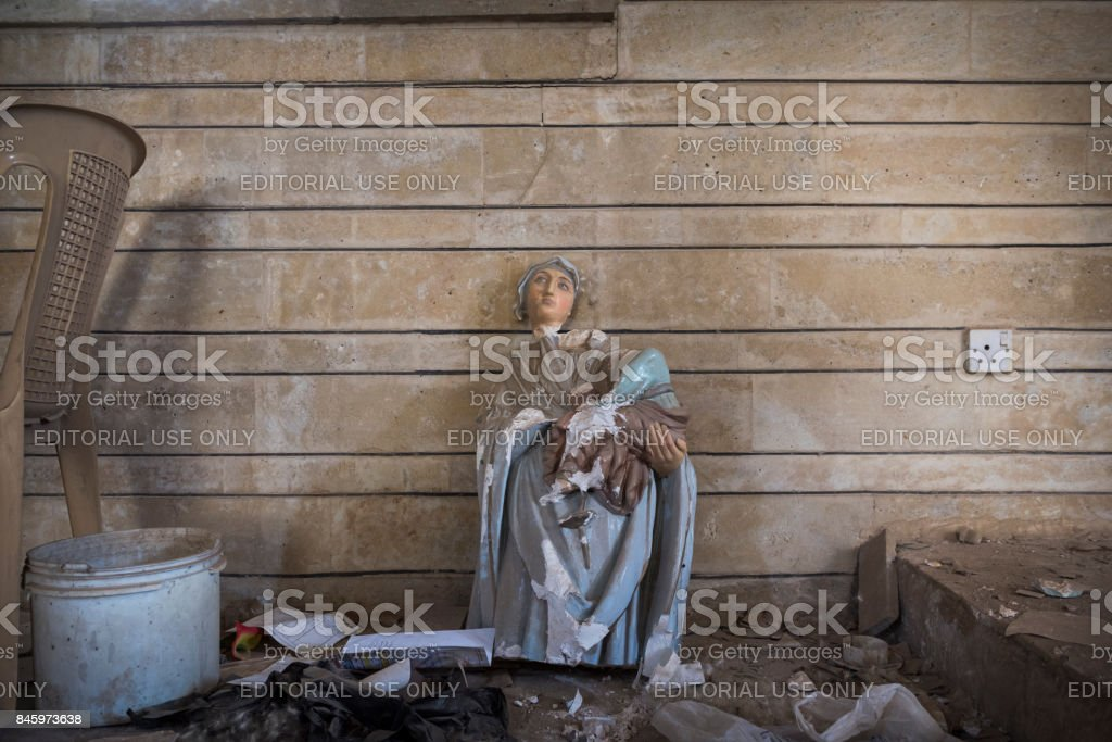 Damaged Virgin Mary statue in Qaraqosh, Iraq stock photo