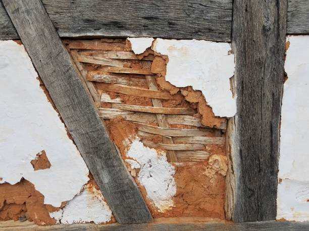 damaged wood and plaster wall stock photo