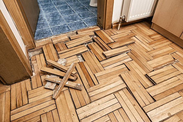 damaged wooden floor - flooded room stock photos and pictures