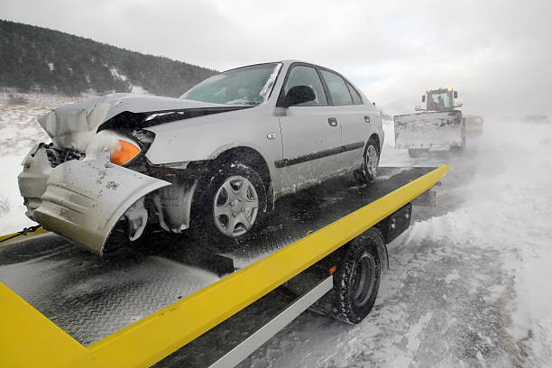 Damages car on the back of a truck after accident stock photo