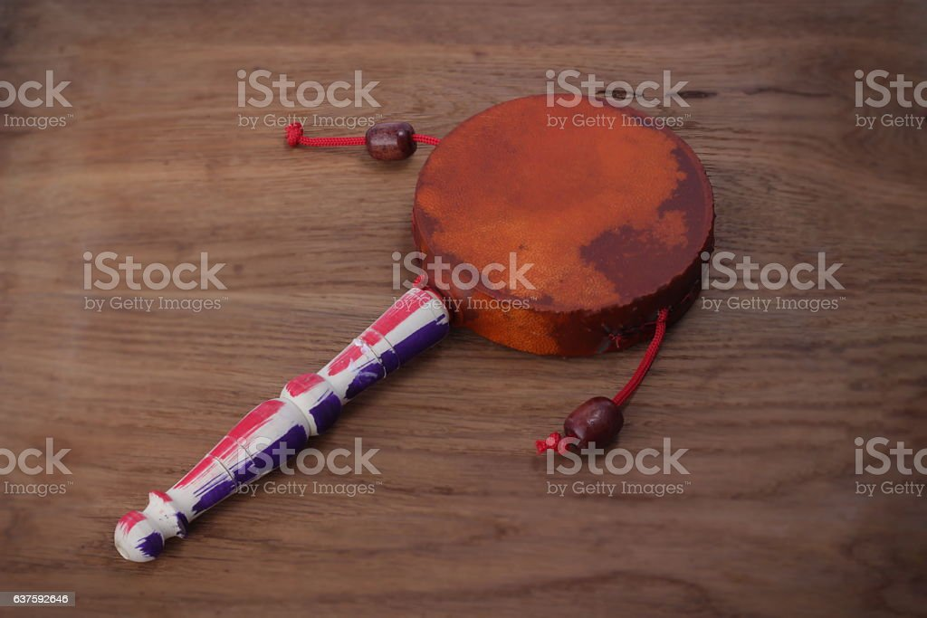 Damaru drum percussion instrument with a handle stock photo