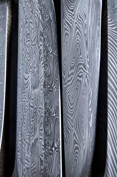 damascus steel blade of knife. closeup of wootz - damaststahl stock-fotos und bilder