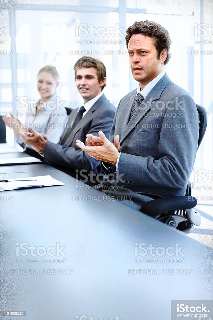 Dan Trunkman applauds a successful meeting royalty-free stock photo