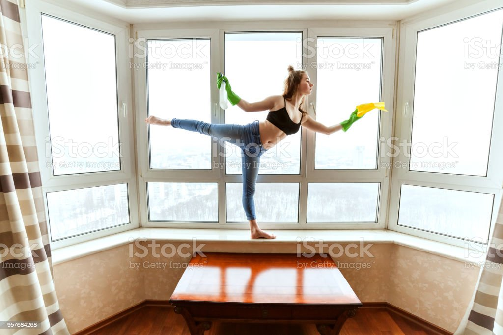 Dance and apartment cleaning. stock photo