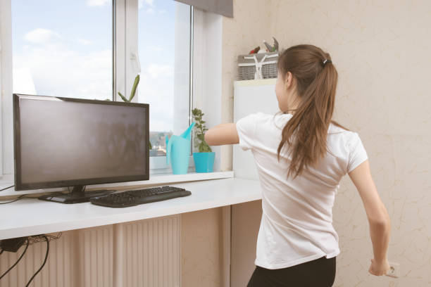 Dance classes during quarantine. Girl does online exercises by video calling stock photo