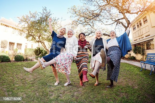 Full length portrait of a group of happy senior women dancing during a hike in the great outdoors