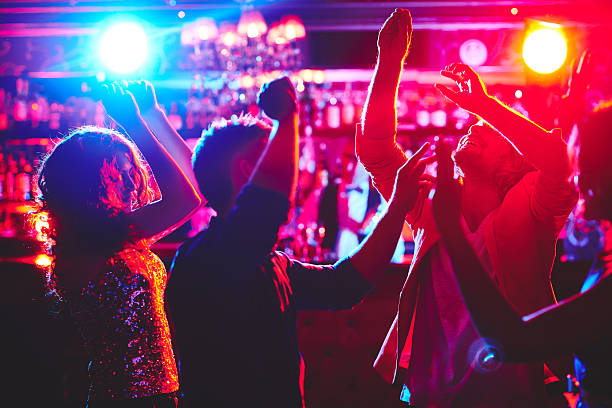 Dance lovers Group of dance lovers enjoying disco in nightclub nightclub stock pictures, royalty-free photos & images