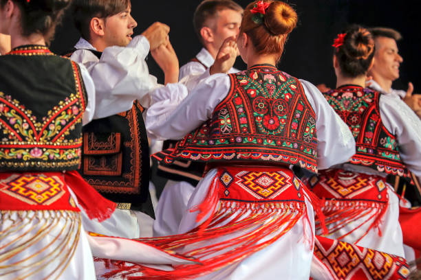 Dance of young Romanian dancers in traditional costume stock photo