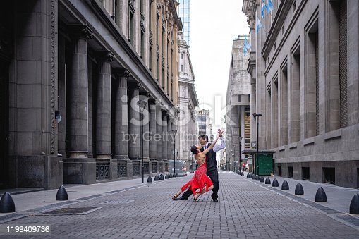 Hispanic male and female tango dancers, dancing on the street of Buenos Aires
