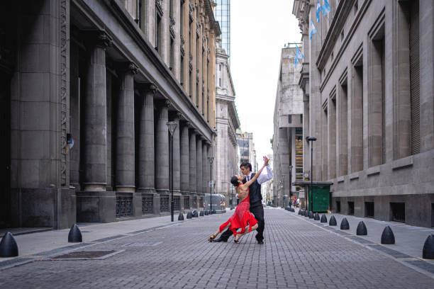 Dance partners performing tango argentino in an old street stock photo