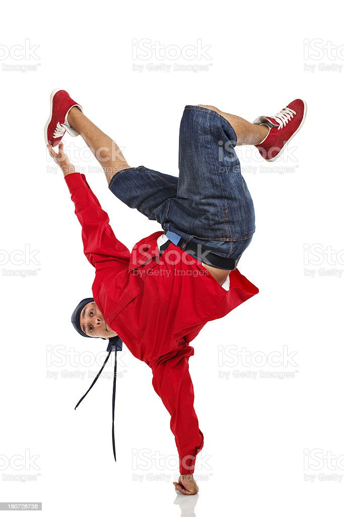 Dancer doing one hand stand stock photo