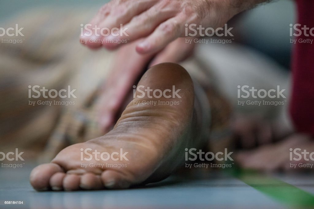 dancer foot and hand on the background of foor stock photo