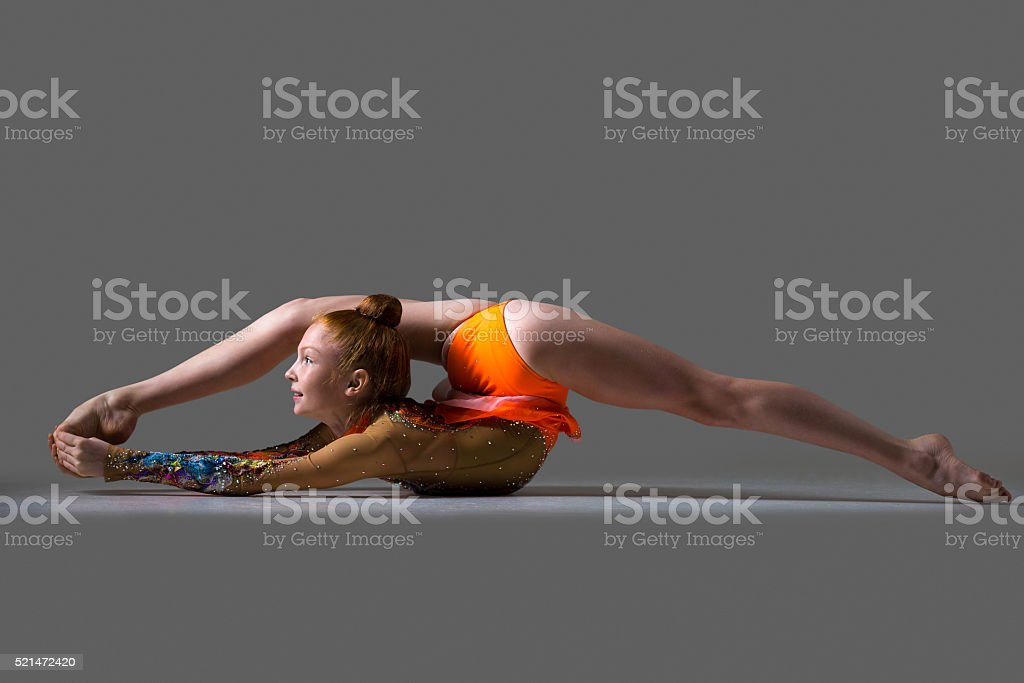 Dancer girl doing backbend acrobatic exercise stock photo