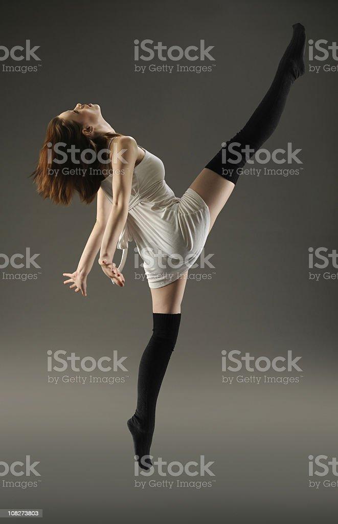 Dancer Girl Jump Kicking High Above Her Head stock photo