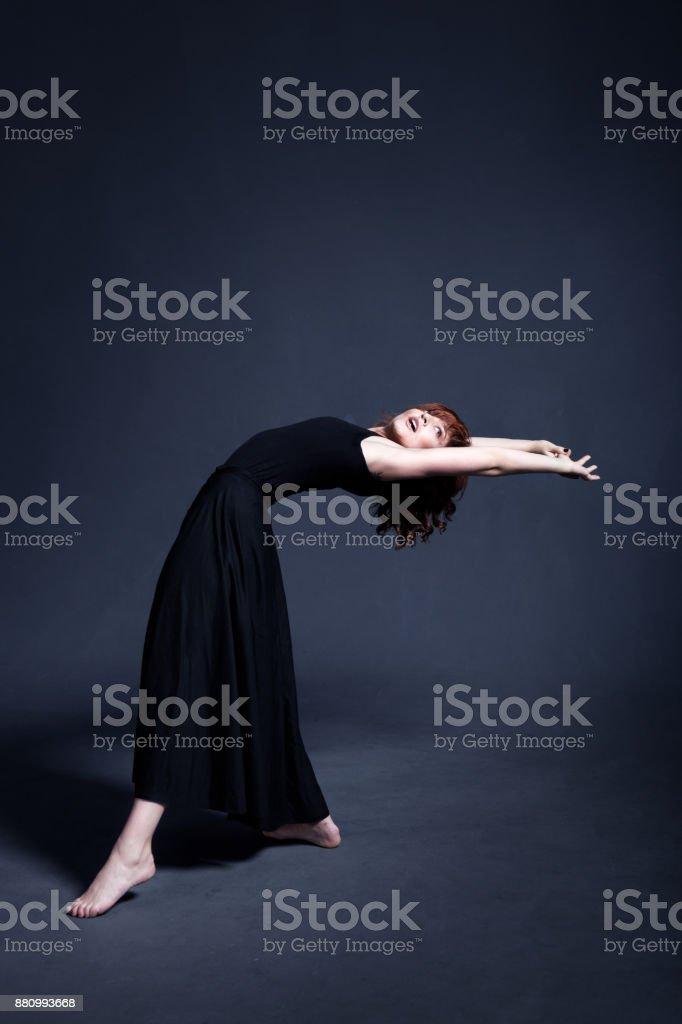 Dancer In A Black Dress Is Dancing In The Dark Studio Stock Photo Download Image Now Istock