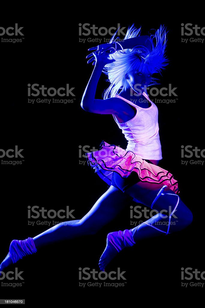 Dancer in black light royalty-free stock photo