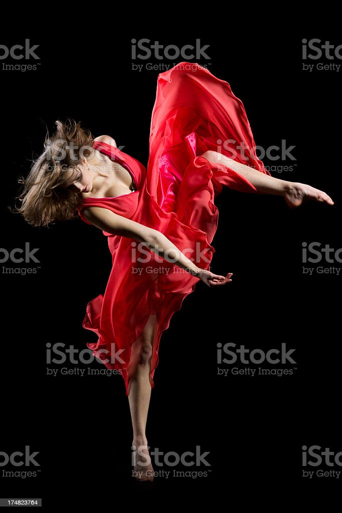 Dancer in midair on black royalty-free stock photo