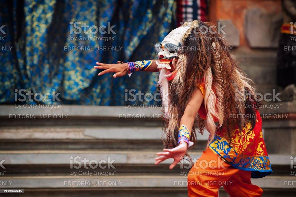 Dancer in traditional Balinese mask of demon Rangda stock photo