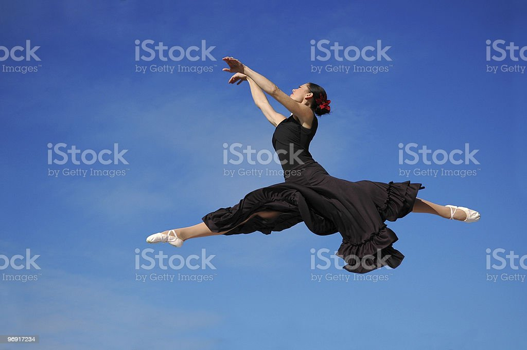 Dancer jumping against blue sky royalty-free stock photo