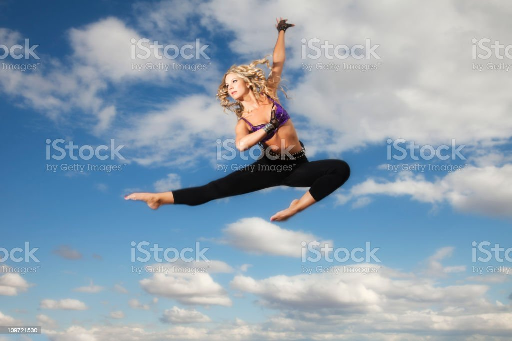 Dancer jumping in the clouds royalty-free stock photo