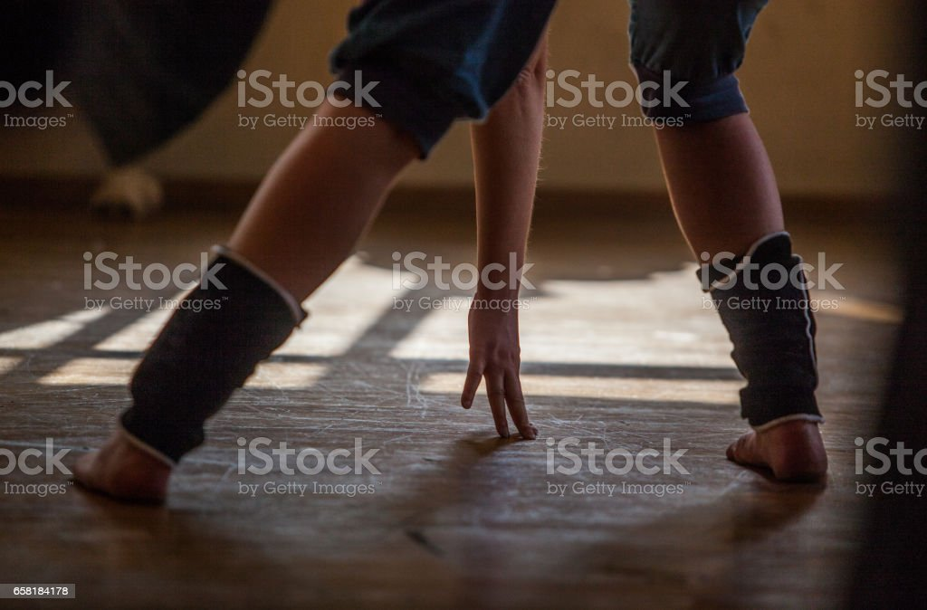 dancer leg and hand on the background of foor with bright reflex stock photo