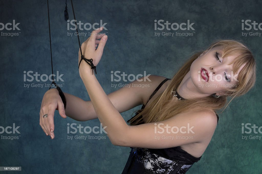 Dancer marionette leaning back with eyes closed. royalty-free stock photo