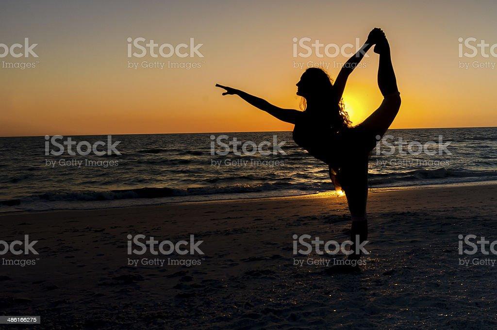 Dancer on a Deserted Beach stock photo